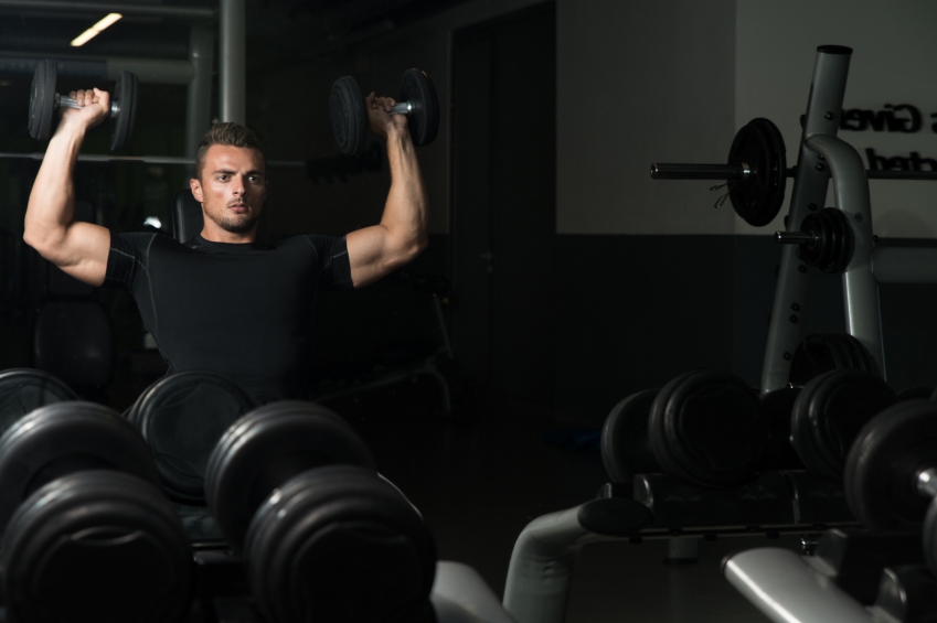 man doing seated dumbbell presses