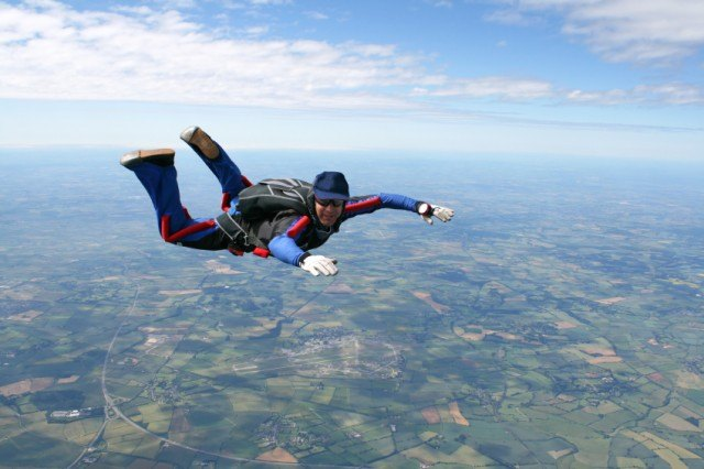 man jumping out of a plane skydiving