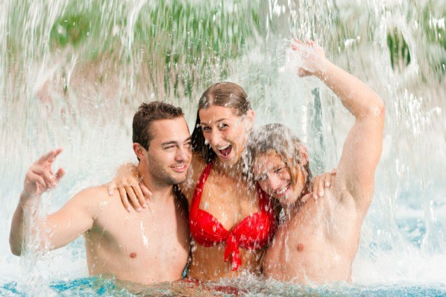 woman with two men at water park