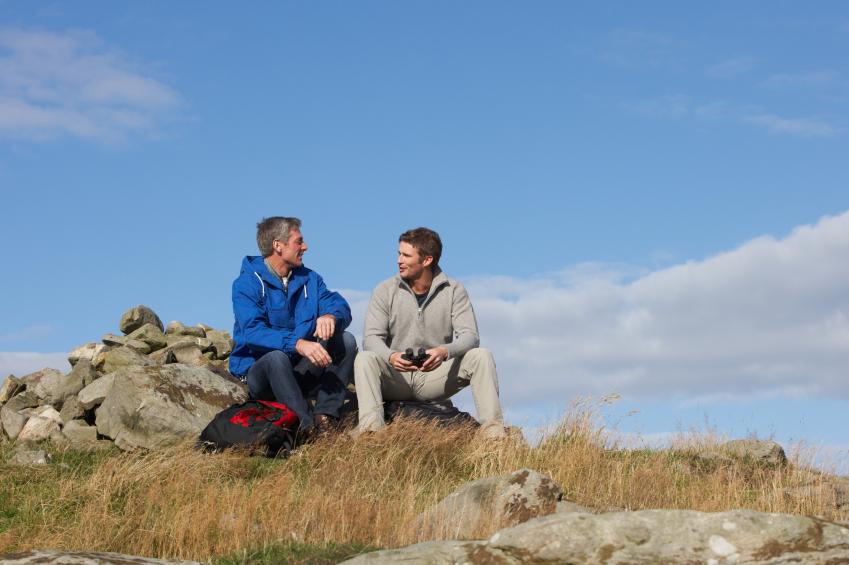 Two men sitting in a rock