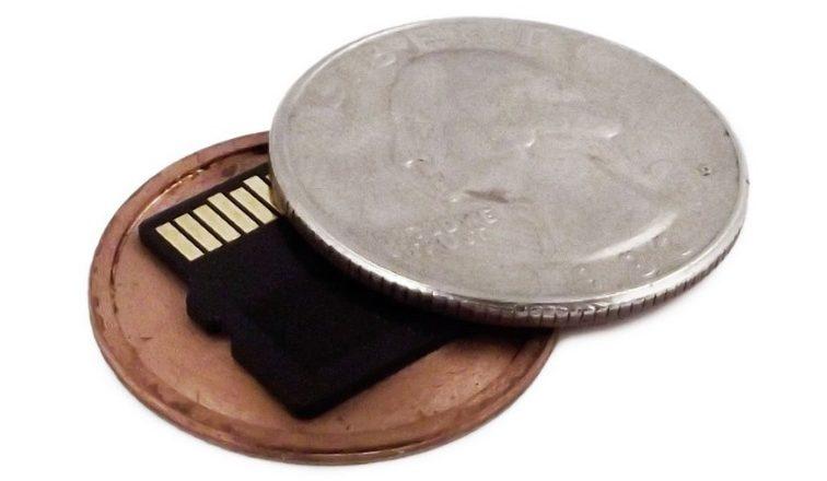 MicroSD card hidden in a coin-shaped case