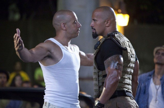 Vin Diesel and Dwayne Johnson stand together, read to fight each other in Fast Five