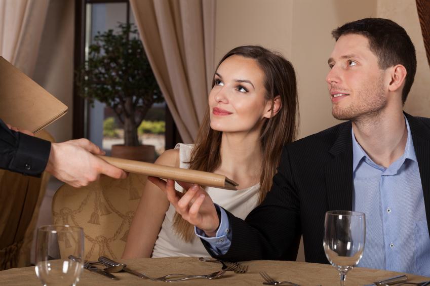 A couple look toward their server
