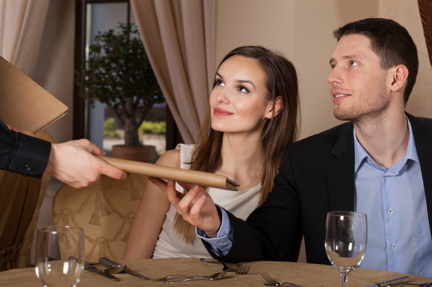 couple receiving menus in a restaurant