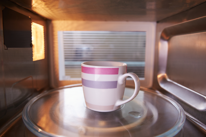 A cup of coffee in a microwave