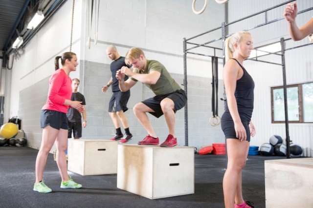 crossfit class practicing box jumps
