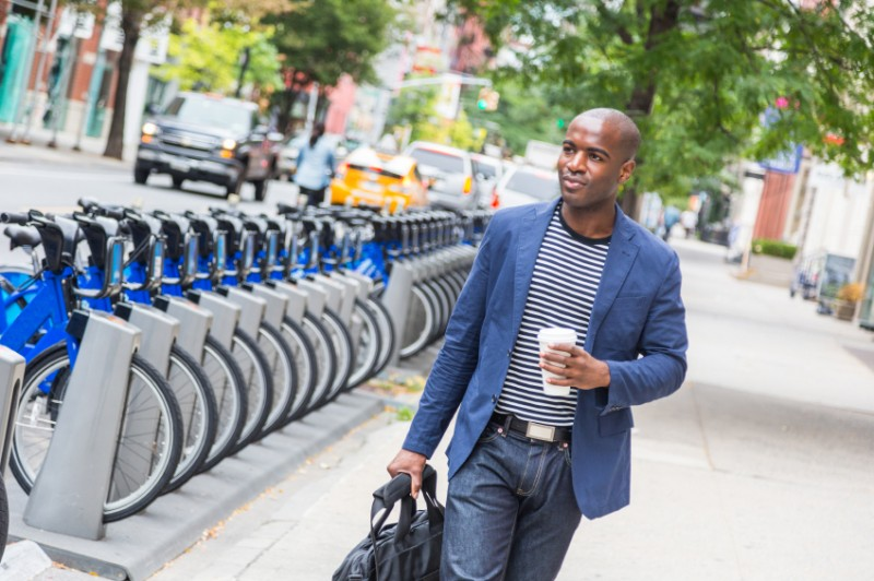 Young Man walking with coffee
