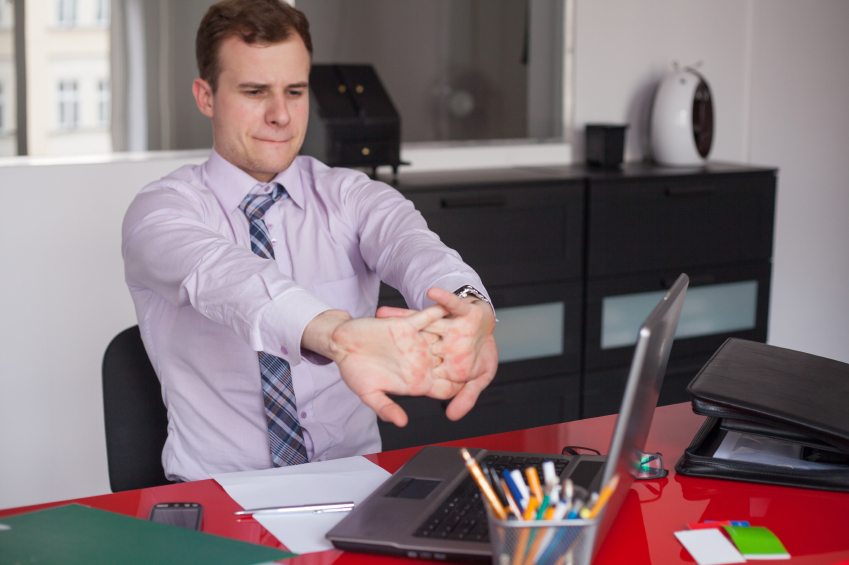 Young businessman working, office, stretching