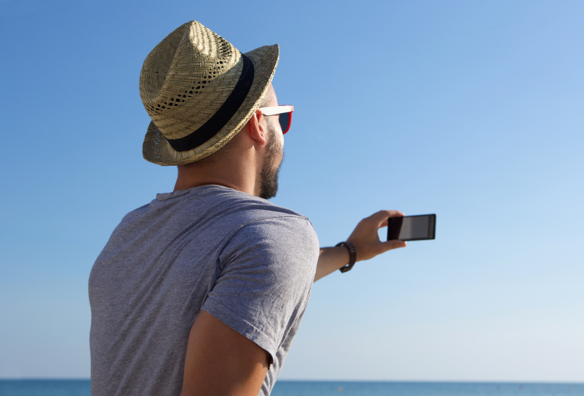 Young man taking selfie by the sea, stylish, travel, phone