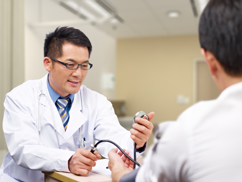 A man getting his blood pressure checked
