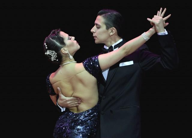 Argentina's dancers Gonzalo Bogado (R) and Jimena Tonanez perform representing the city of Tigre during the Stage Tango competition of the Tango World Championship 2014 in Buenos Aires on August 26, 2014. AFP PHOTO / DANIEL GARCIA (Photo credit should read DANIEL GARCIA/AFP/Getty Images)