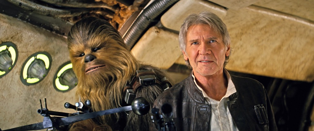 Han and Chewie standing together smiling in a hallway, looking to the left of the frame