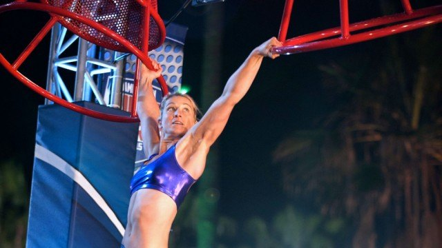 Jessie Graff has each hand on ladders on American Ninja Warrior.