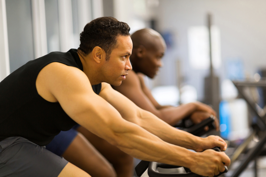 men working out with stationary bike, cycling, exercise
