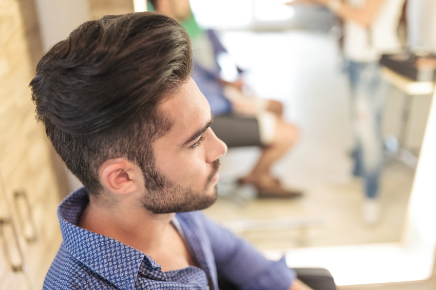 seated young casual man with nice hairstyle, style