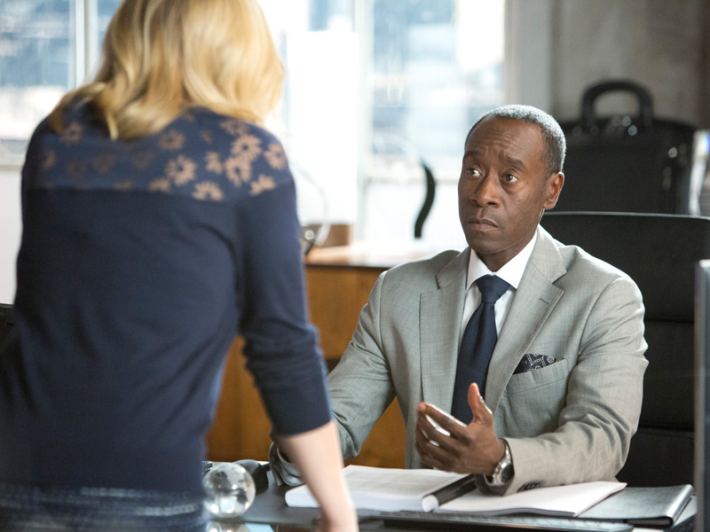 Don Cheadle sits at a desk in House of Lies
