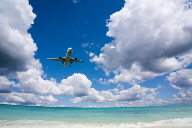 Airplane flying over a beach
