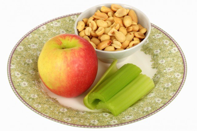 Apple, nuts, and celery on plate.