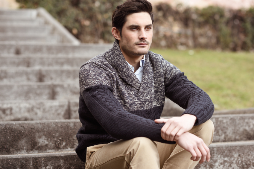 Man in sweater looking straight forward