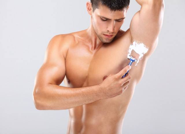 Man shaving under his arms