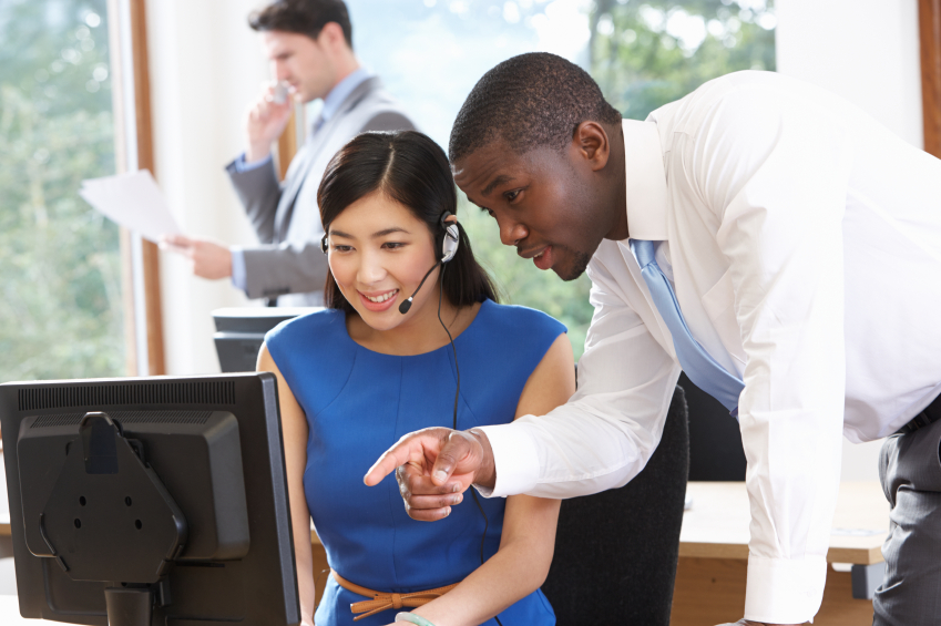 man helping woman at work