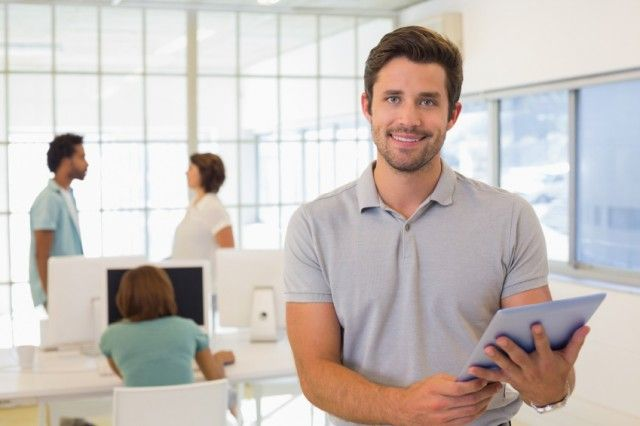 man with tablet in office