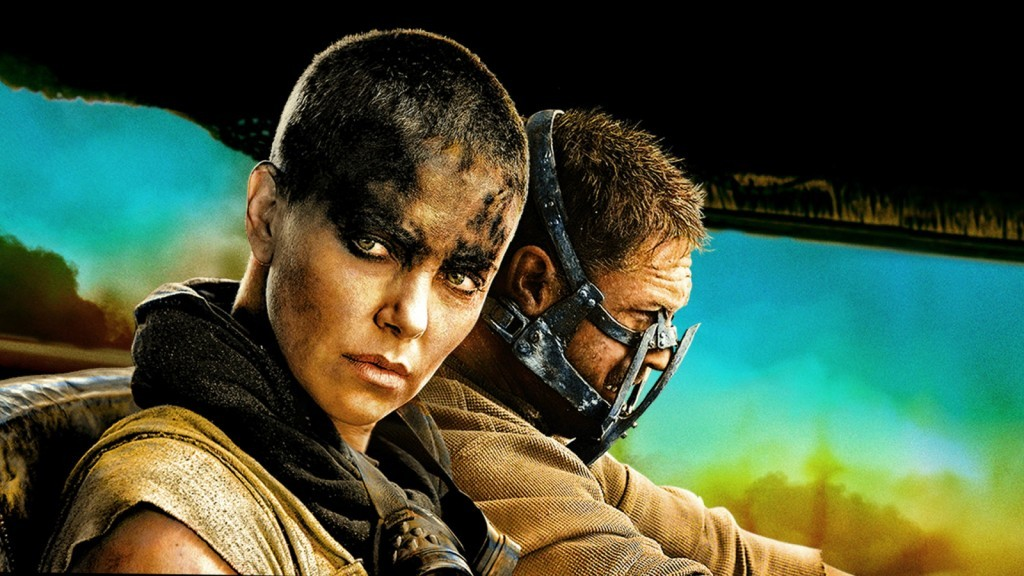 Charlize Theron looks to the side as she sits next to Tom Hardy in Mad Max: Fury Road Warner Bros.