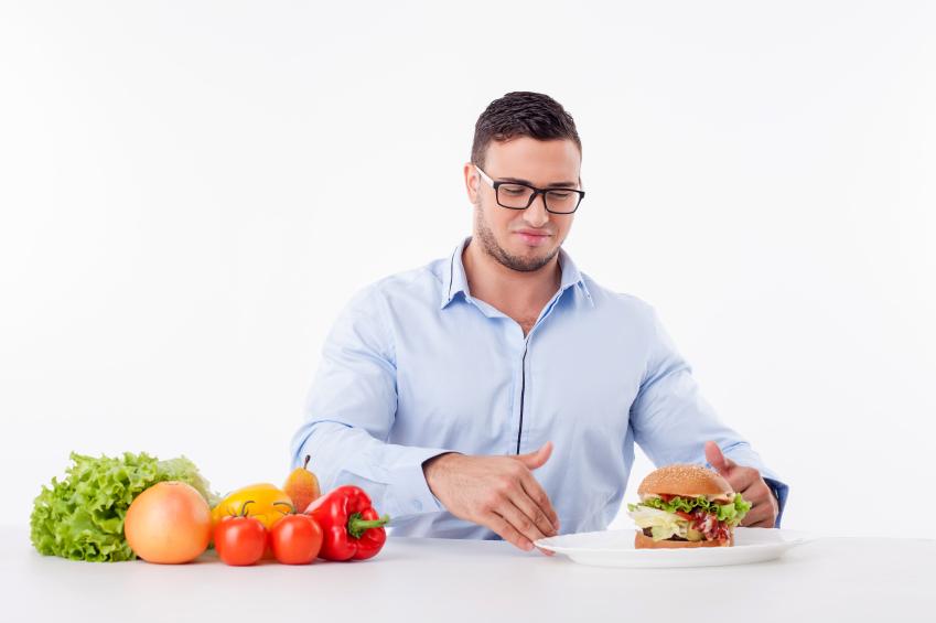 a man refusing to eat a hamburger