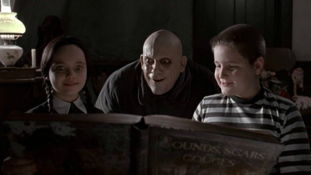 Christina Ricci, Christopher Lloyd and Jimmy Workman in 'The Addams Family'