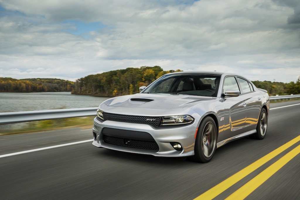 The Dodge Charger SRT 392 drives down a scenic road, showcasing its 485 horsepowe