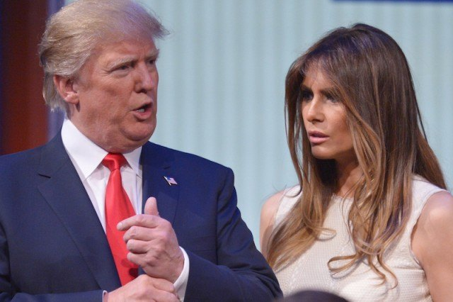 Donald Trump and his wife Melania Trump standing next to each other.