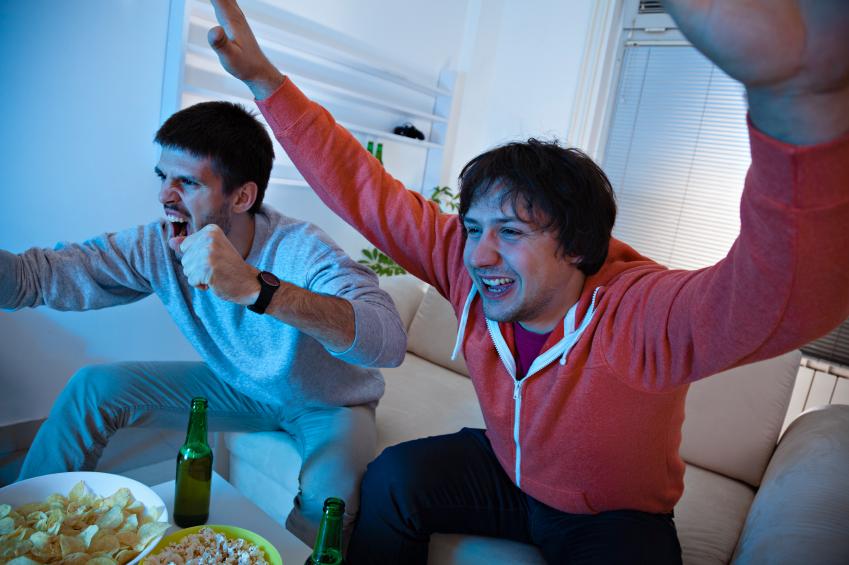 two guys watching tv
