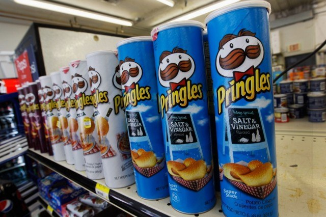 Rows of Pringles on a store shelf