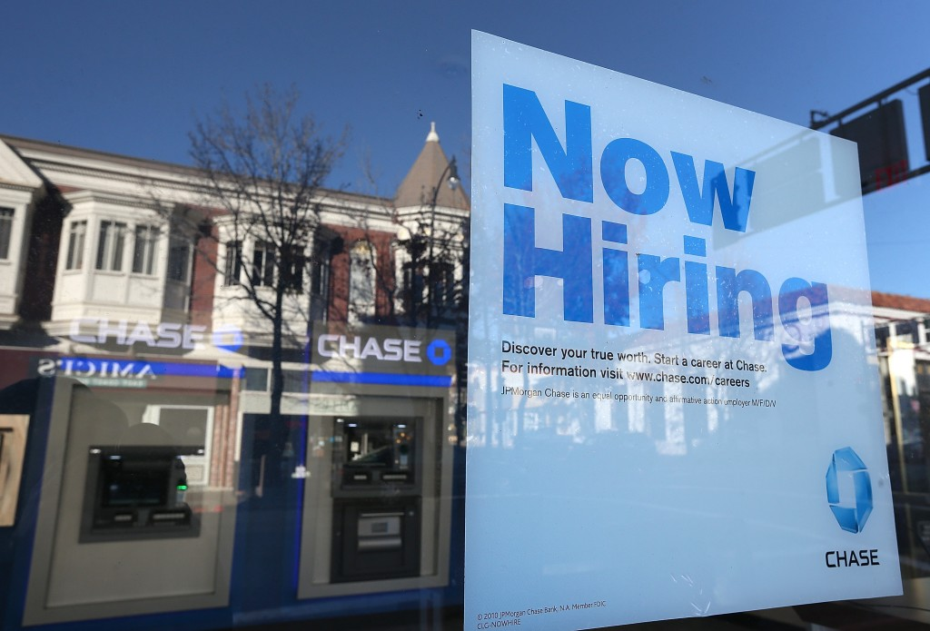 "A ""now hiring"" sign at Chase"