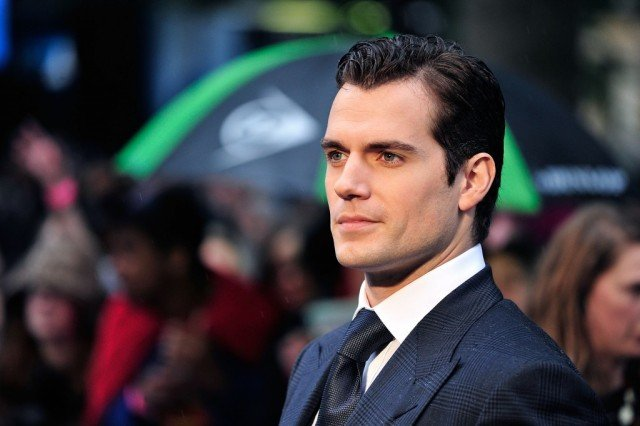 Henry Cavill poses for cameras on the red carpet