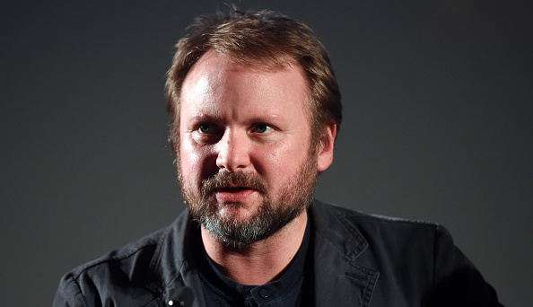 A press photo of Rian Johnson, glancing to the left of the frame