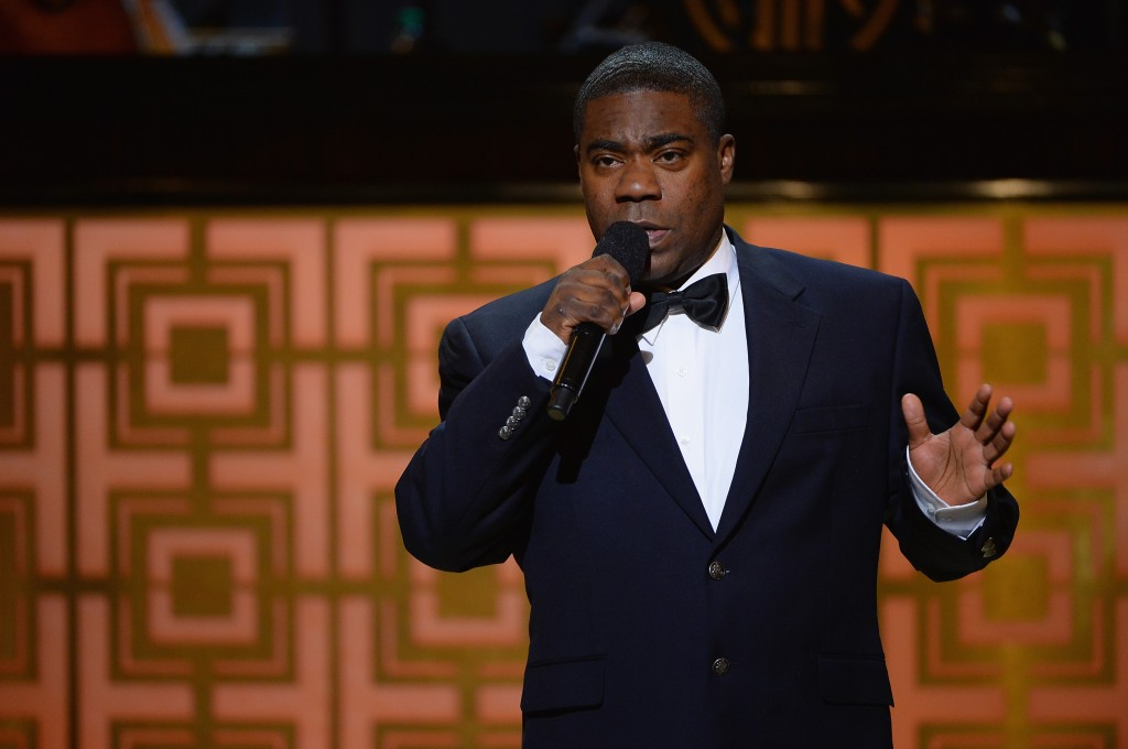 Tracy Morgan holds a microphone while speaking at an awards show.