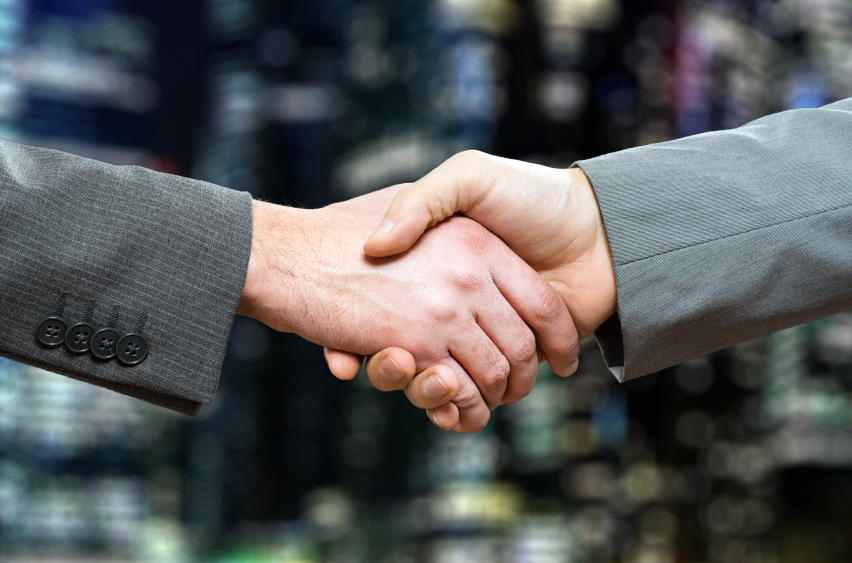 two men shaking hands after networking meeting