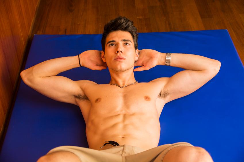 man exercising on a mat