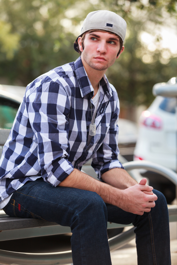 man in a hat and plaid shirt