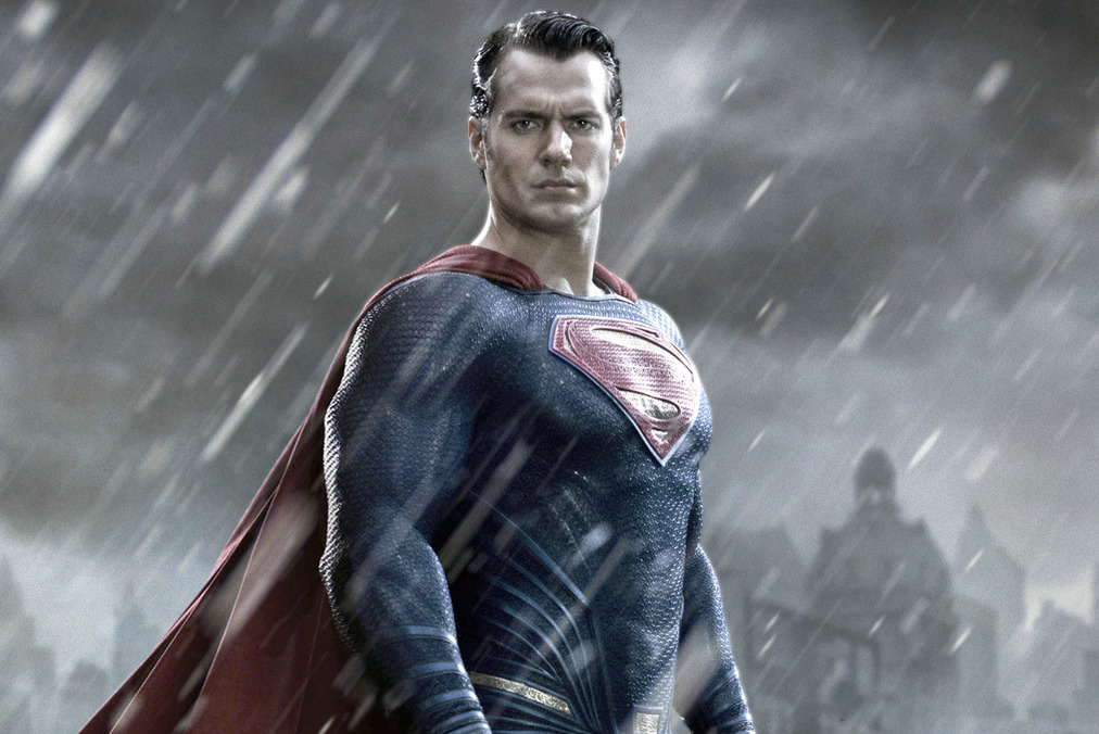 Henry Cavill as Superman stands in the rain and looks ahead