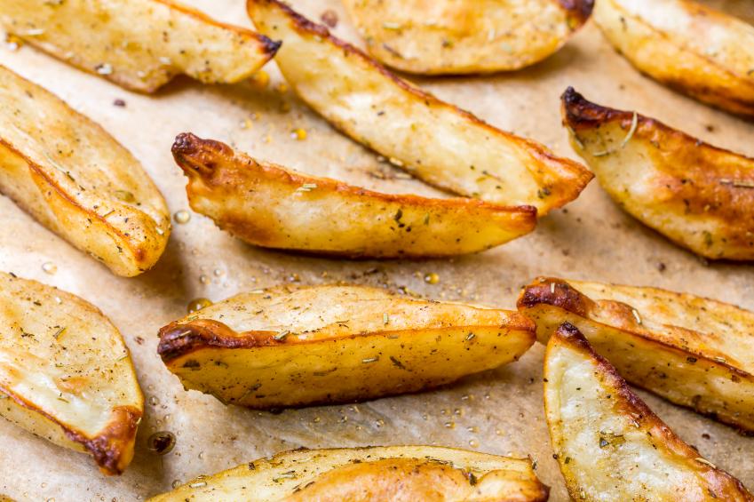 tray full of freshly baked oven fries