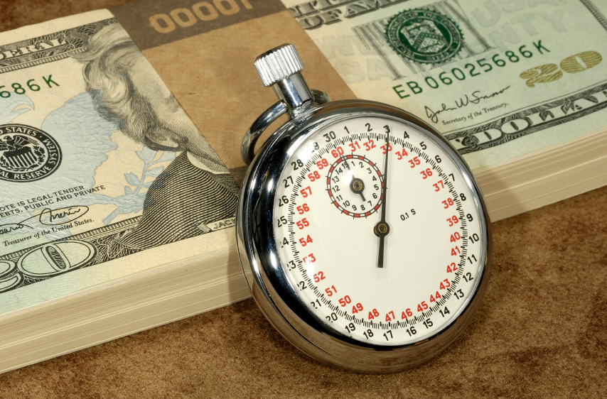 time clock and money, hourly wages