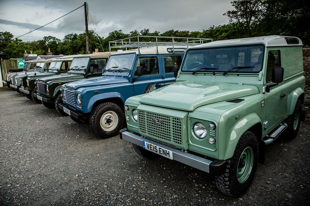 Land Rovers in a line
