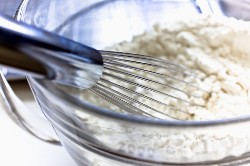 bowl of flour with whisk