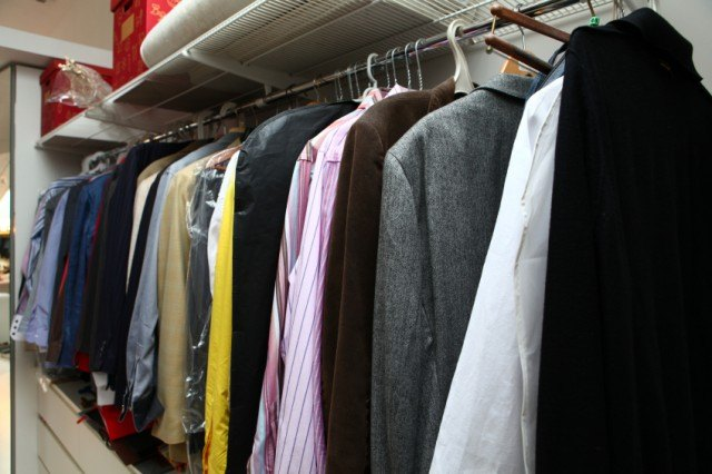 Shirts and blazers hanging in a closet
