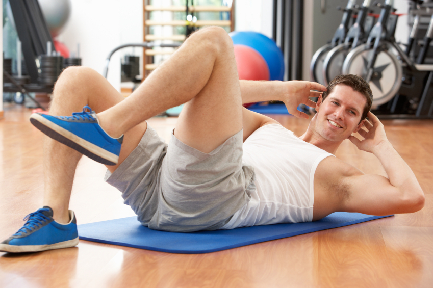 man working his abs on a mat