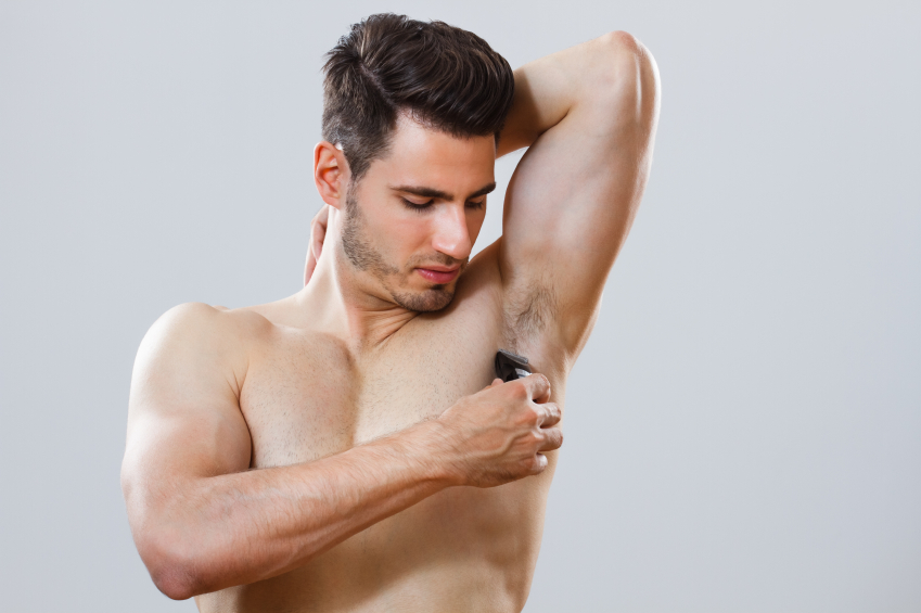 Man shaving his armpit