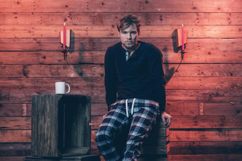 Man with blonde hair and beard wearing winter sleepwear, pajamas, style