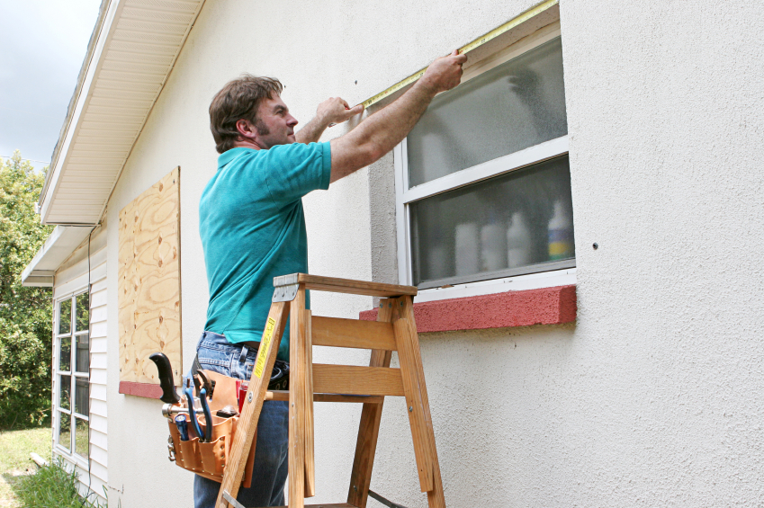 A man fixes a window